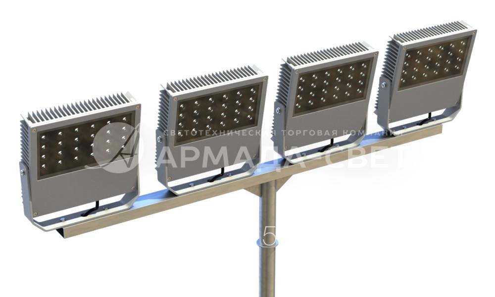 На фото изображен Т-образный кронштейн с установленными на нем 4 светодиодными светильниками. Особенность состоит в том, что каждый из световых приборов имеет собственную скобу для регулировки угла наклона корпуса и позиционирования светового потока. За счет этого можно подсветить нужный участок объекта.